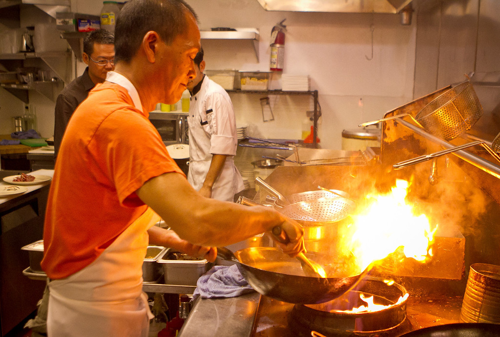 Chef Huaquan Ye cooks the stir fried Cumin Lamb at Yiping restaurant in San Ramon on Wednesday, September 12th, 2012.
