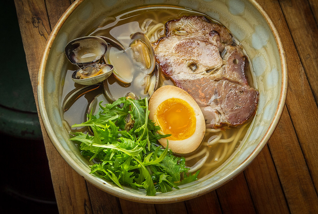 The Shio ramen with Manila Clams, spit-roasted Liano Seco Chasu, marinated Egg, and Mizuna at the Ramen Shop in Oakland, Calif. is seen on Friday, February 15th, 2013.