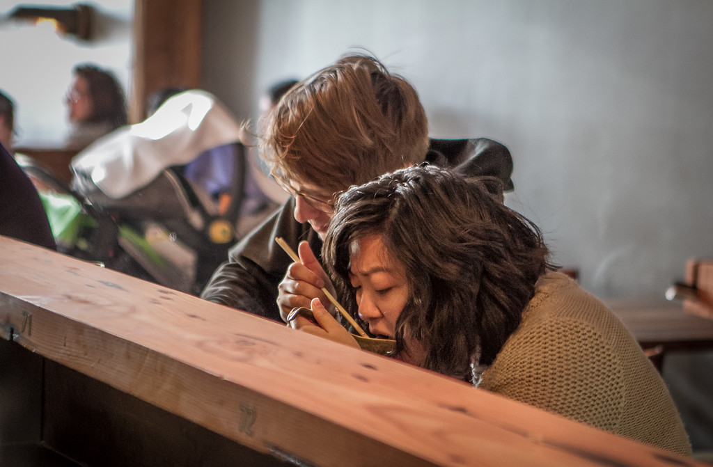 A couple enjoy bowls of Ramen for dinner at the Ramen Shop in Oakland, Calif. on Friday, February 15th, 2013.