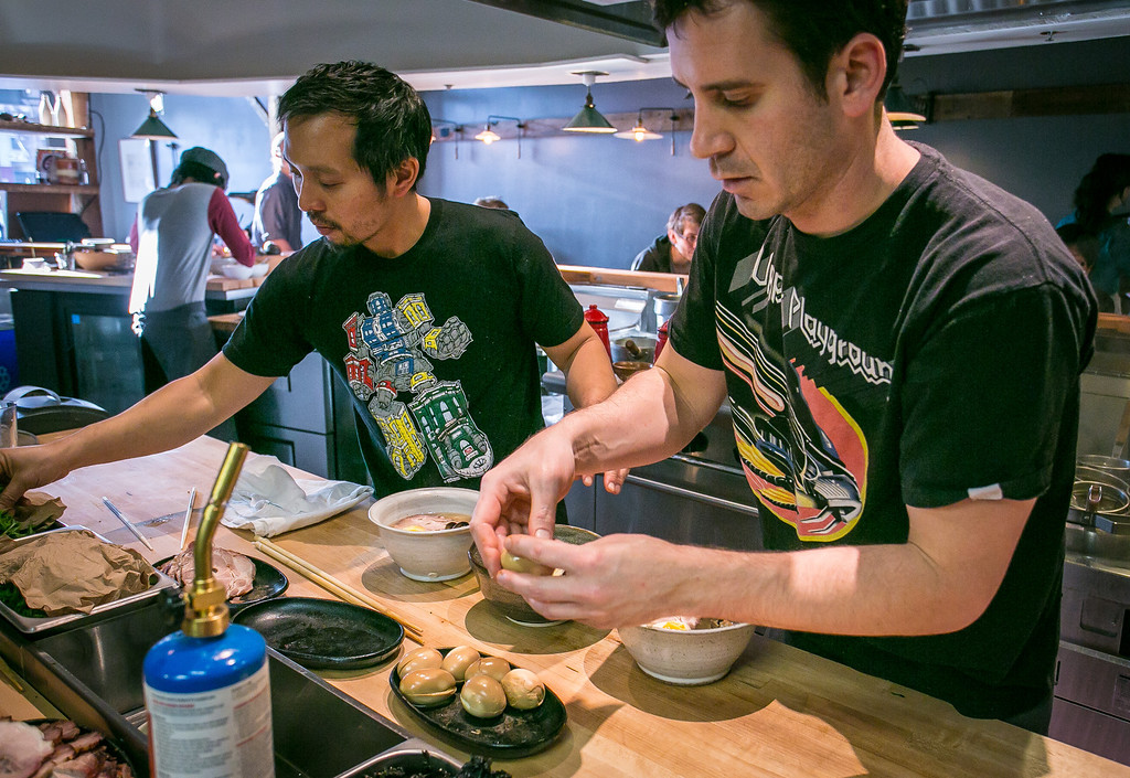 Rayneil De Guzman, left, and Jerry Jaksich make Ramen at the Ramen Shop in Oakland, Calif. on Friday, February 15th, 2013.