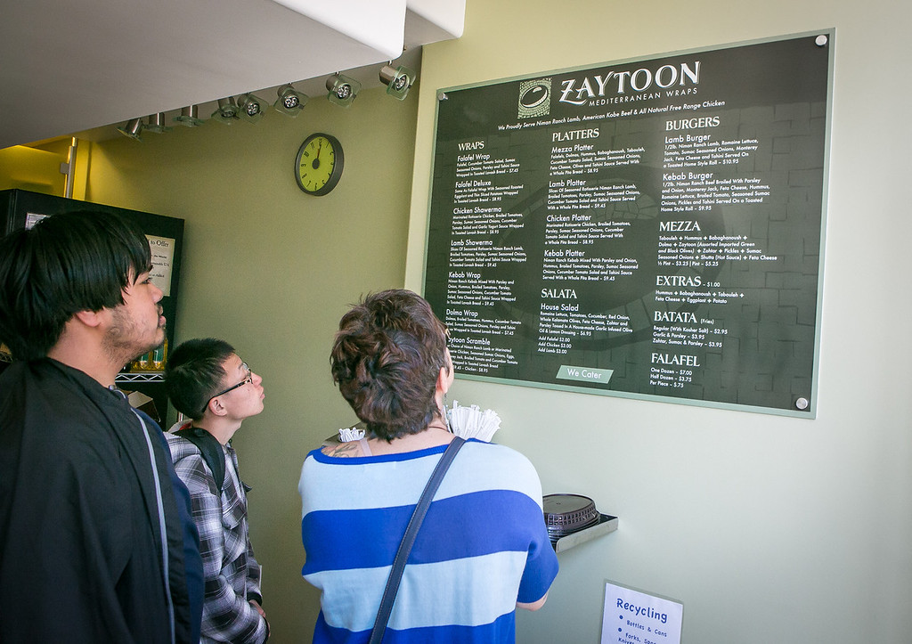 People look at the menu at Zaytoon Restaurant in San Francisco, Calif. on Friday, February 15th, 2013.