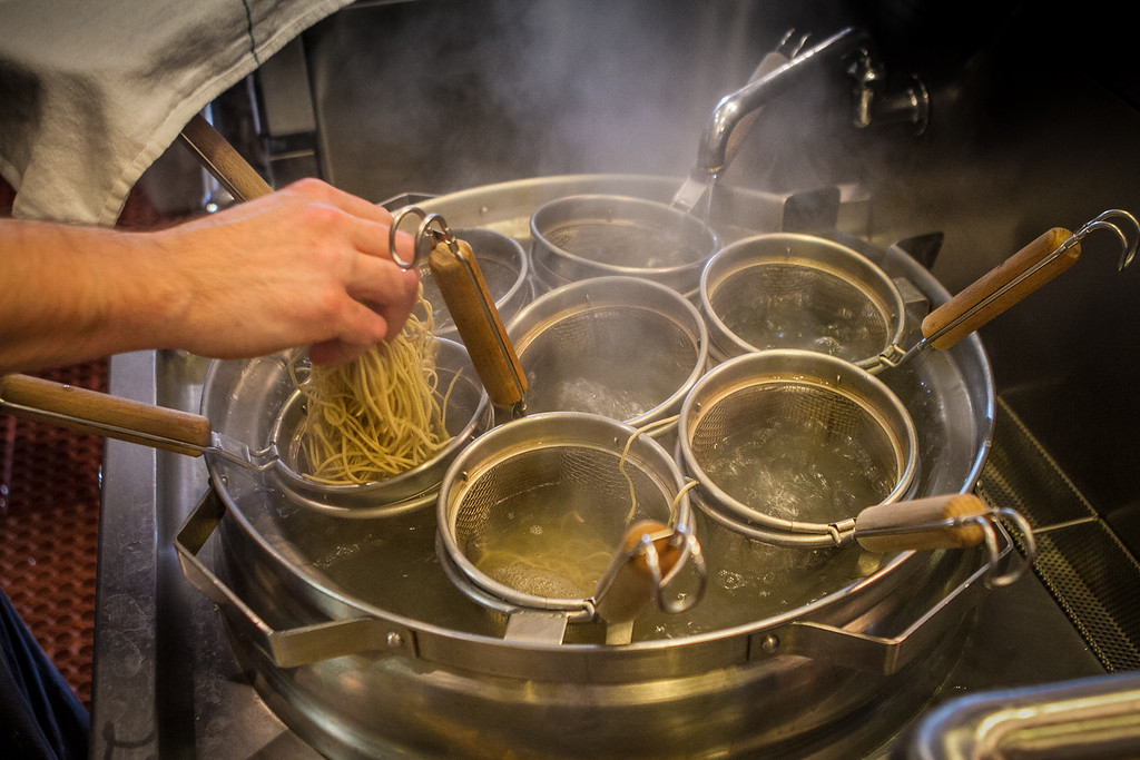 Ramen being dropped into boiling water at the Ramen Shop in Oakland, Calif. on Friday, February 15th, 2013.