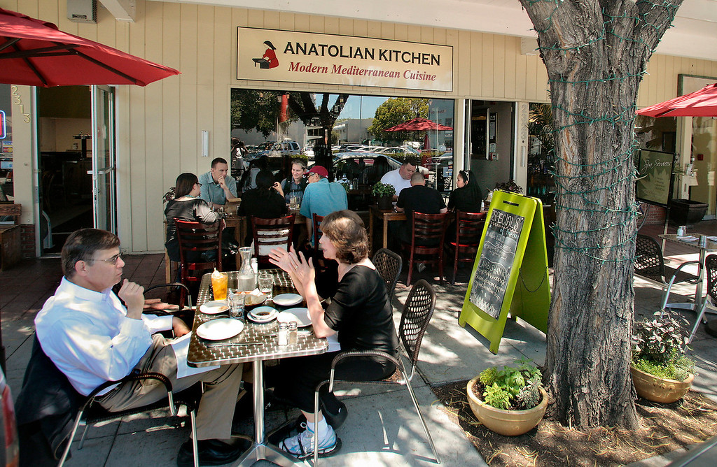 Diners Outside On The Sidewalk At Anatolian Kitchen In Palo Alto, Calif.,  Are