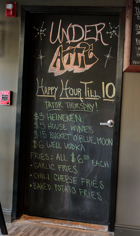 The Happy Hour specials board at the Attic restaurant in San Mateo, Calif. is seen on Thursday, April 7th,  2011.