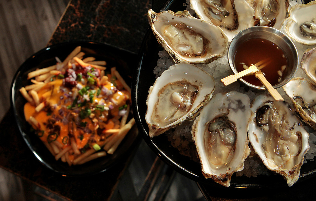 Oysters with the Chili Cheese fries at the Attic restaurant in San Mateo, Calif. is seen on Thursday, April 7th,  2011.
