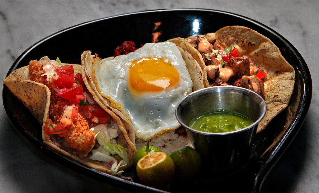 """The Fish Taco, the Sisig Taco and the """"Wow"""" Silog Taco at the Attic restaurant in San Mateo, Calif. is seen on Thursday, April 7th,  2011."""