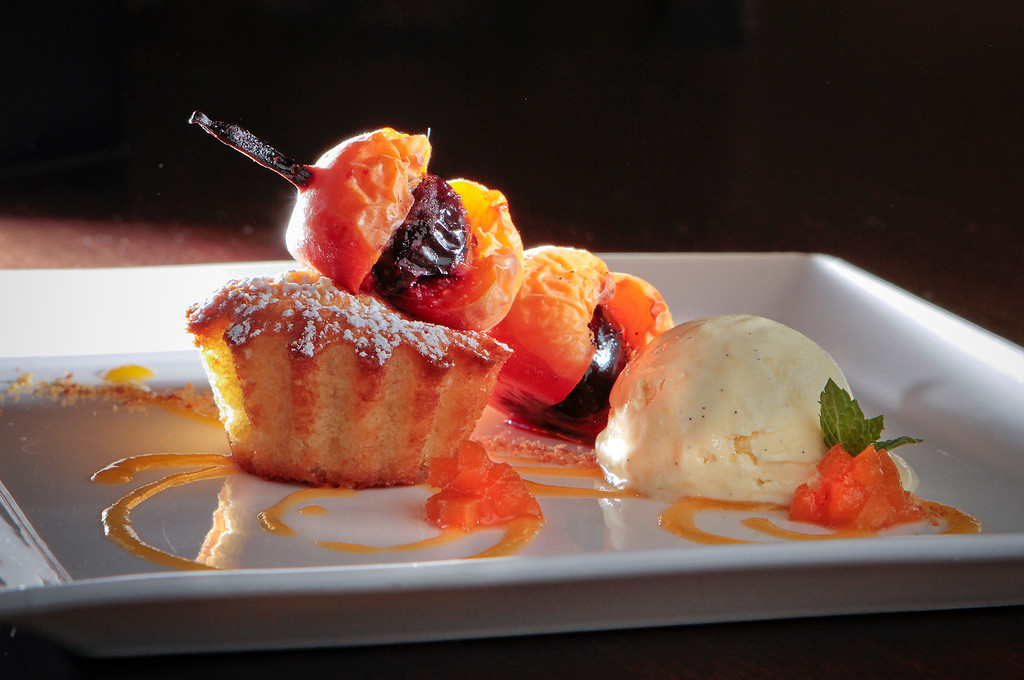 The Roasted Apricots, Cherry Hearts, Almond Cake and Noyau Ice Cream at Bar Terra in St. Helena, Calif., is seen on July 15th, 2011.