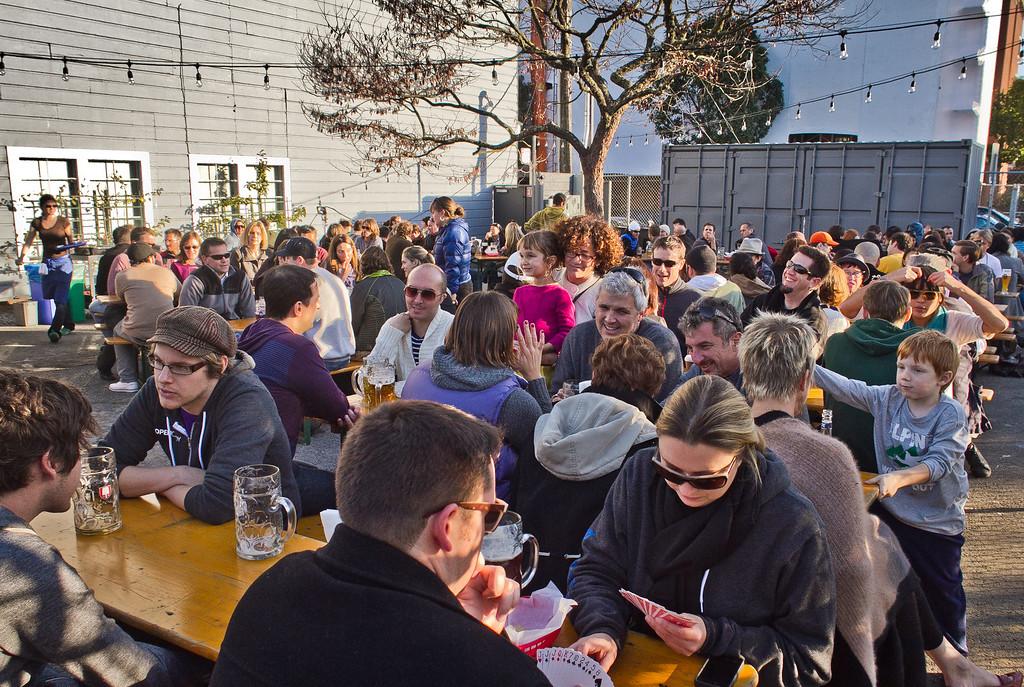People enjoy beer at the Biergarten Restaurant in San Francisco, Calif.,  on Sunday, December 4th,  2011.