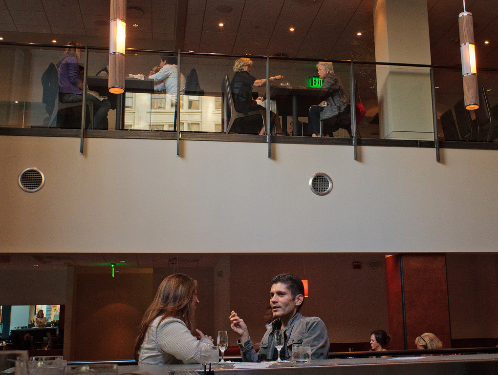 A couple enjoys a drink at the bar at Bluestem Restaurant in San Francisco, Calif., on August 9th, 2011.