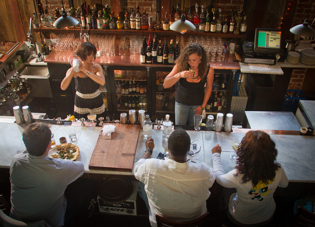 Bartenders make drinks for customers at Boot and Shoe Service restaurant in Oakland, Calif., on September 7th, 2011.