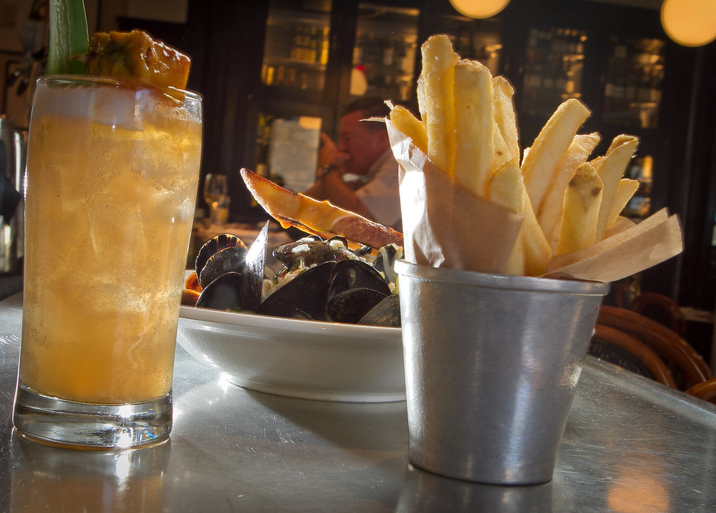 The Moules Frites with the Zombie cocktail at Cafe Des Amis in San Francisco, Calif., is seen on Tuesday, November 1,  2011.