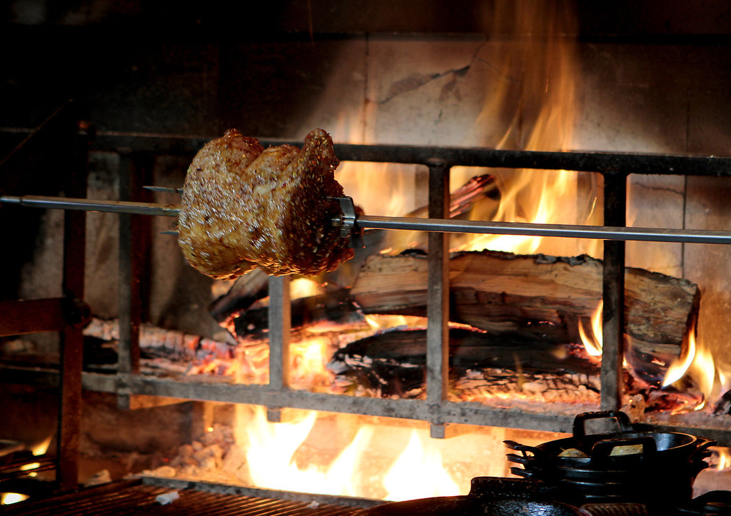 A rack of Pork cooks on the wood fired rotisserie at Cotogna Restaurant in San Francisco, Calif., on June 9th, 2011.