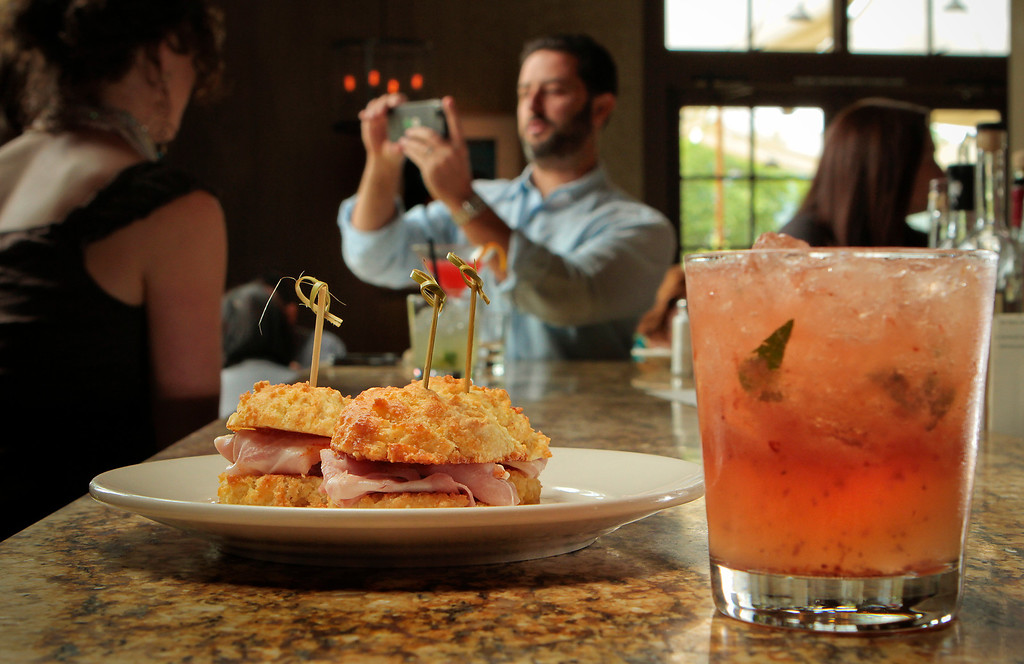 The Cured Ham Sandwiches with a Dimmi Hendricks cocktail at the Farmstead restaurant in St. Helena, Calif., is seen on Saturday, May 28th, 2011.