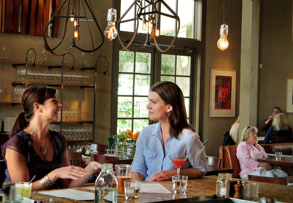 Two friends enjoy drinks at the Farmstead restaurant in St. Helena, Calif., on Saturday, May 28th, 2011.