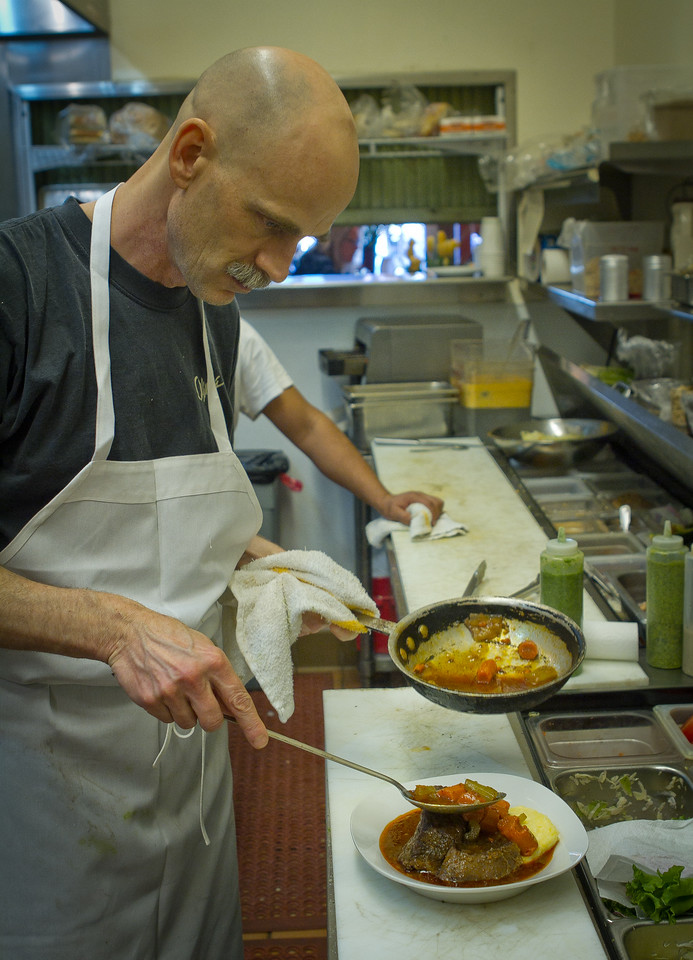 Chef John Littlewood plates the Pot Roast at the Gypsy Cafe in Sebastopol, Calif., on Thursday, December 1st,  2011.
