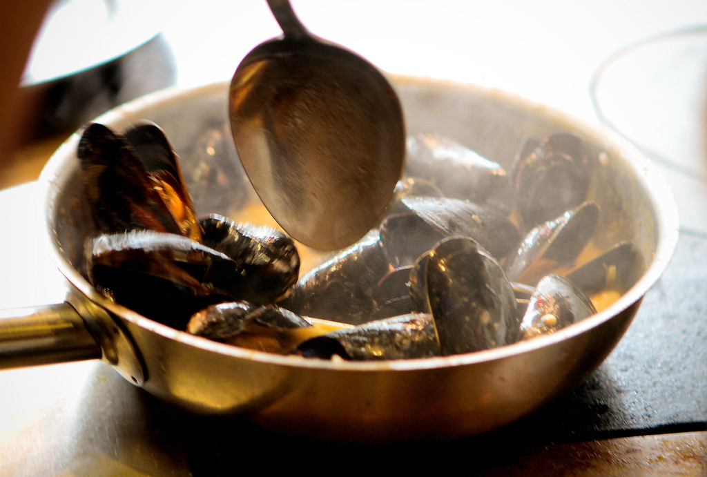 Mussels being cooked at Hawker Fare restaurant in Oakland, Calif., on July11th, 2011.
