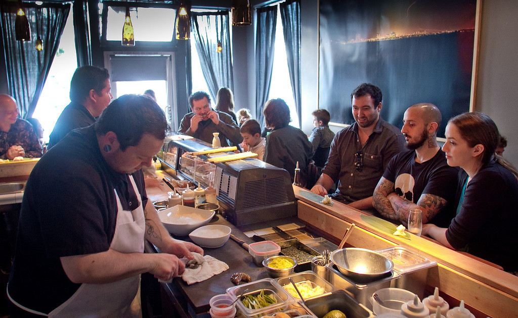 Diners watch cook Jake Whitlock make sushi at Ichi Sushi in San Francisco, Calif., on September 16th, 2011.