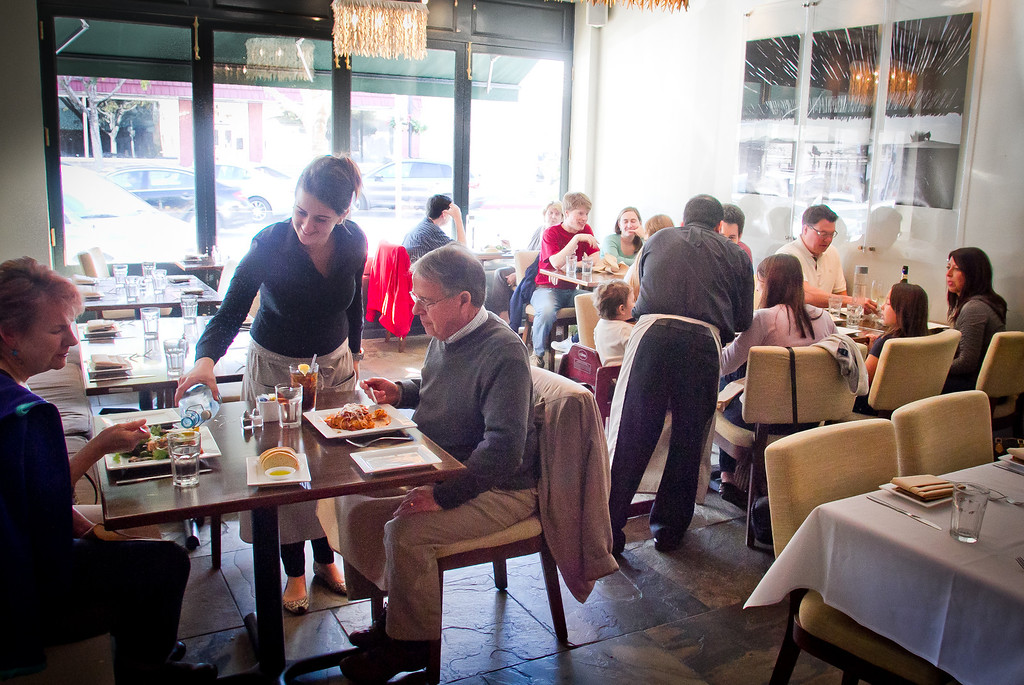 Diners enjoy lunch at  Locanda Positano restaurant in San Carlos, Calif.,  on Friday, November 25th, 2011.