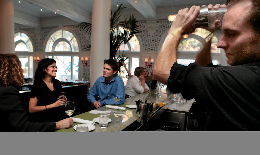 Bartender Remik Starkharper shakes a Basil Gimlet at the restaurant Five in the Hotel Shattuck Plaza in Berkeley, Calif., is seen on Friday, October 1,  2010.