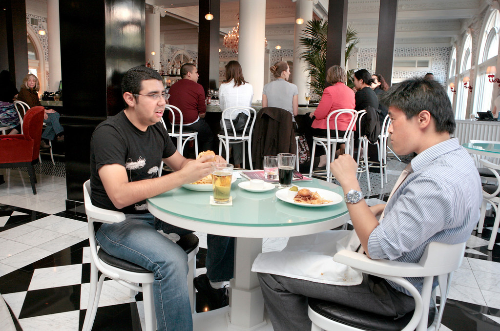 Maximus Lih (right) has a bite with Carlos Corro at the restaurant Five in the Hotel Shattuck Plaza in Berkeley, Calif.,  on Friday, October 1,  2010.