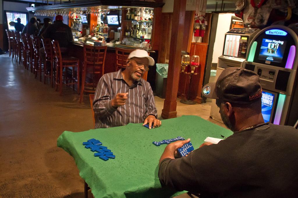 Two men play Dominoes  at Sam Jordan's Bar in San Francisco, Calif.,  on Tuesday,  October 18, 2011.