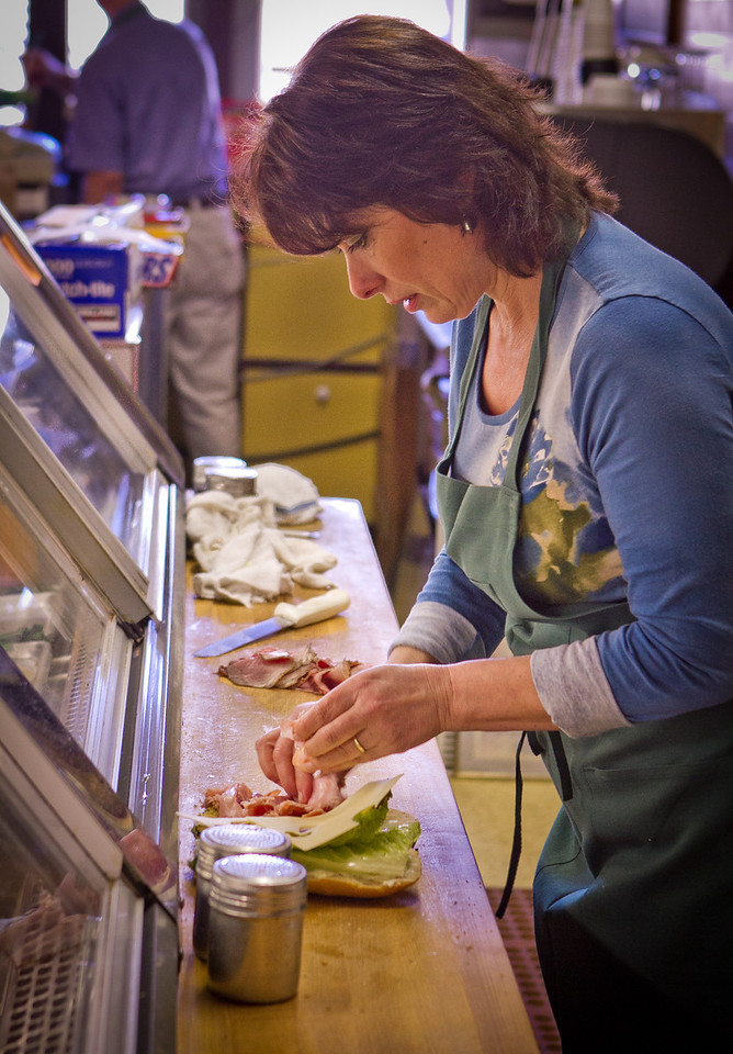 Eve Hontalas makes a sandwich at the Sausalito Gourmet Deli, Calif.,  is seen on Thursday, November 10,  2011.