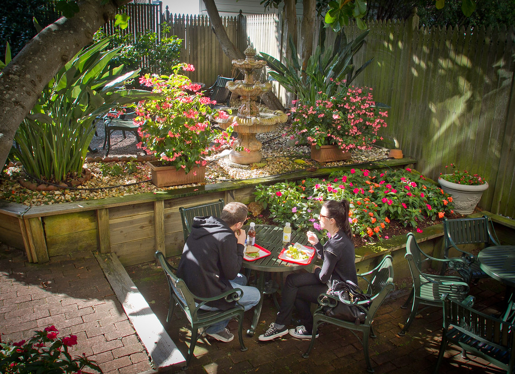 A couple enjoys lunch in the courtyard patio at the Sausalito Gourmet Deli, Calif., on Thursday, November 10,  2011.