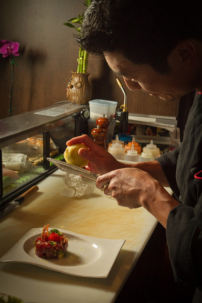 Chef Kuo Hwa Chuang grates Lemon Zest over the Hawaiian Style Poke at Seiya Restaurant in San Carlos, Calif., on September 22, 2011.