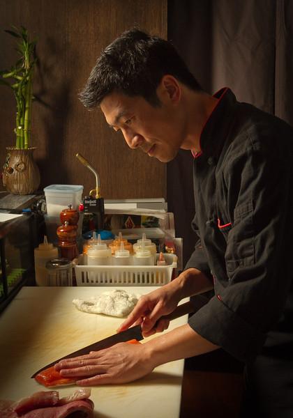 Chef Kuo Hwa Chuang cuts Salmon at Seiya Restaurant in San Carlos, Calif., on September 22, 2011.