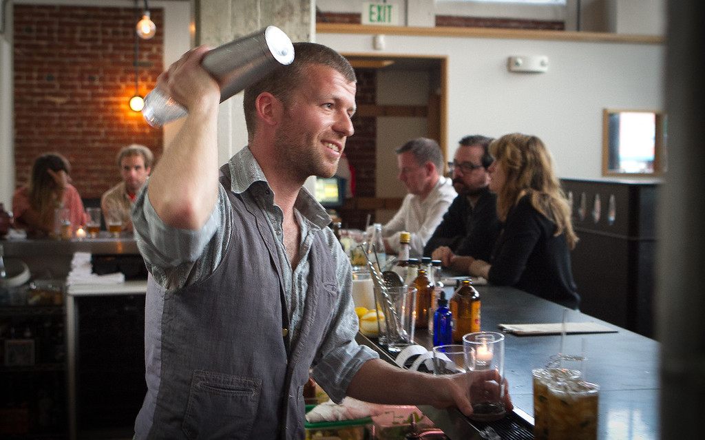 Bartender Roland Blandy shakes a cocktail at Serpentine Restaurant in San Francisco, Calif., on Saturday,  September 24th, 2011.