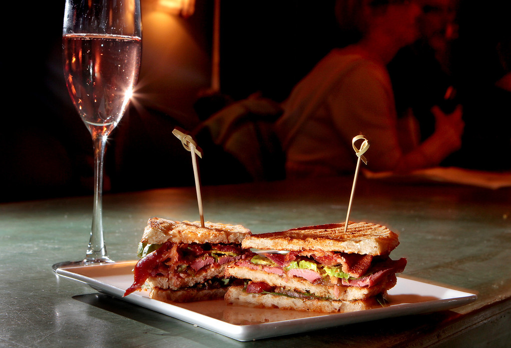 The smoked Duck Club sandwich with a glass of brut rose at Stomp, wine and small plate lounge in Danville, Calif., is seen on Saturday, Nov. 20, 2010.