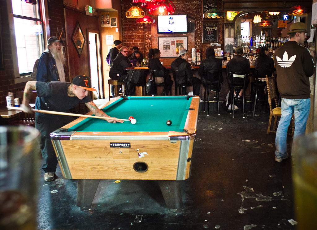 Customers enjoy drinks and pool during happy hour at the Tempest in San Francisco, Calif., on September 14th, 2011.