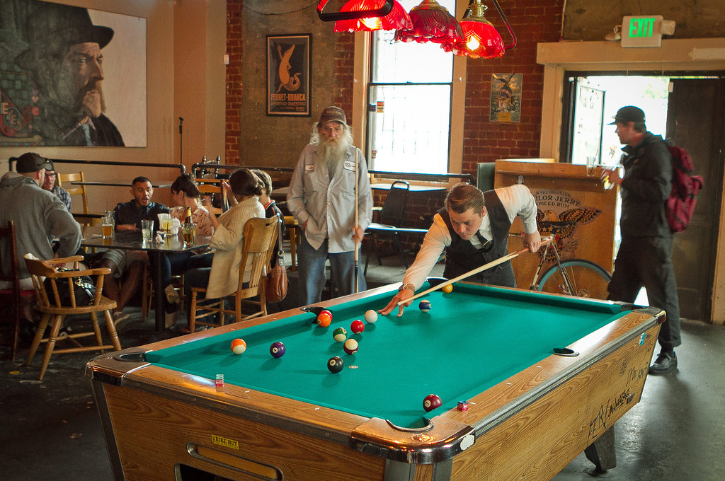 Customers play pool during happy hour at the Tempest in San Francisco, Calif., is seen on September 14th, 2011.
