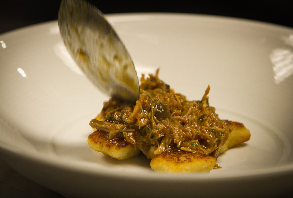 The braised Niman ranch Pork with Gnocchi being plated at Trace Restaurant in San Francisco, Calif., on Friday, November 4,  2011.