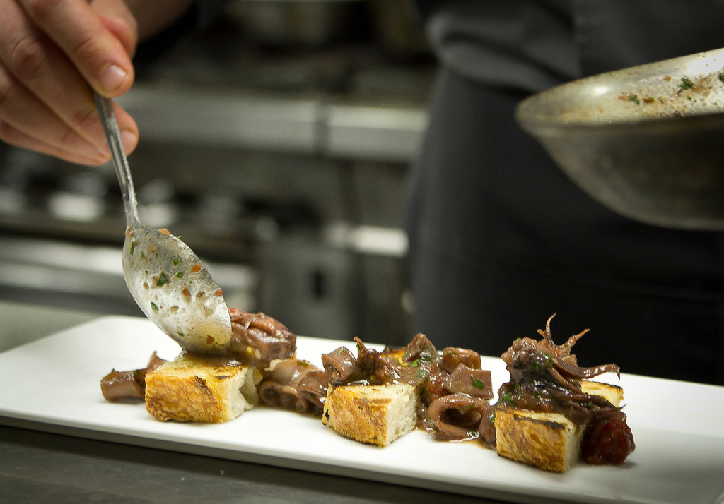 The braised Monterey Squid being plated at Trace Restaurant in San Francisco, Calif., on Friday, November 4,  2011.
