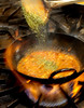 Spices are added to a curry being cooked at the Urban Curry in San Francisco, Calif., is seen on Friday, Nov. 5, 2010.