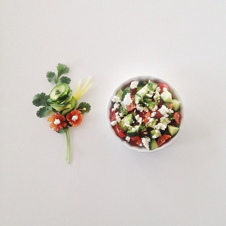 Cucumber and tomato salad with feta cheese, cilantro and a squeeze of lemon juice.
