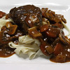 "Short Ribs & Aromatic Vegetables braised in ""Wildberry Syrah"" (wine created by Nancy Gohr), served on a bed of Freshly Made Egg Noodles."