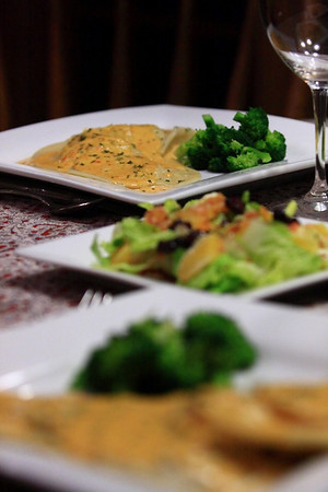 Ravioli filled with Seasoned Smoked Whitefish topped with a Spicy Red Pepper Cream Sauce, served with fresh Buttered Brocolli, and a Hearts of Romaine Salad with Scallion, Orange, and Blackberry Vinairgrette dressing.
