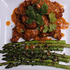 Crispy Coconut & Panko Breaded Shrimp covered with Red Curry Coconut Milk Sauce with Ginger, Onions & Thai Chili, served with fresh Asparagus, Shallots, Ginger & Black Sesame Seeds sauteed in Sesame Oil.