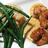 Main course - Wassabi Crusted Prawns & Mango Ginger Coulis, Classic Risotto and Fresh Green Beans.