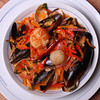 Clams, Mussels & Seared Scallops with Vegetables, Rice Stick and spicy Thai Red Curry Broth