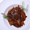 Pan Seared Lamb Chop with Fennel, Onion, Mushroom, & Tomato Ragout.