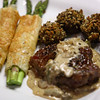 Pepper Crusted Strip Steak with Cognac Mushroom Cream Sauce, Roasted Asparagas Parmesan wrapped in Filo, Panko Stuffed Baby Portobellas.