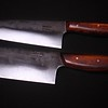 Hand forged knives from the Muteki series by Carter Cutlery, Top: 5.15 sun Wa-Bocho,; Bottom 4.49 sun Nakiri.