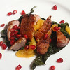 Pan Seared Duck Breast with Clementines, Pomegranate and Braised Kale.