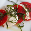 Caprese salad with tomatoes so freshly picked from the garden that they were still sun warm.