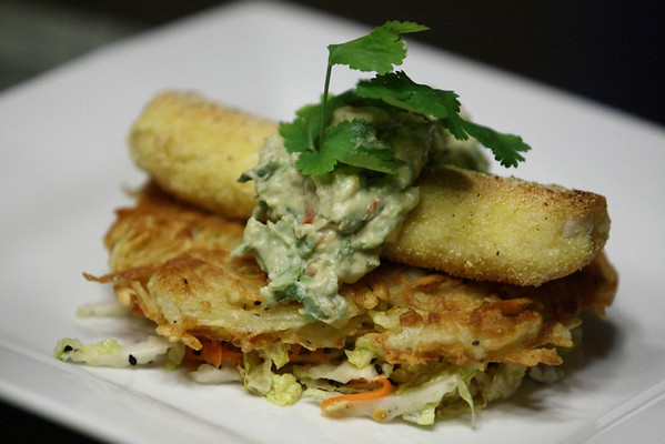 Pan Fried Haddock Loin with Avocado Creme Fraiche Salsa on a Potato Pancake on a bed of Spicy Napa & Black Sesame Seed Slaw.