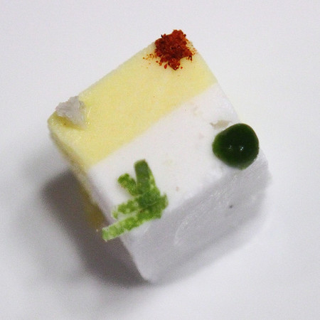 Another Alinea recipe -- Corn and Coconut Sorbets garnished with Mint Puree, Lime Zest, Sea Salt and Cayenne Pepper.