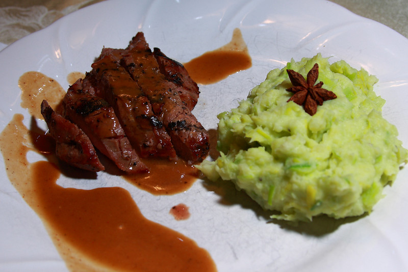 Pan Fried Filet of Beef with Madiera Mustard Sauce, Wassabi Mashed Potato garnished with Star Anise.